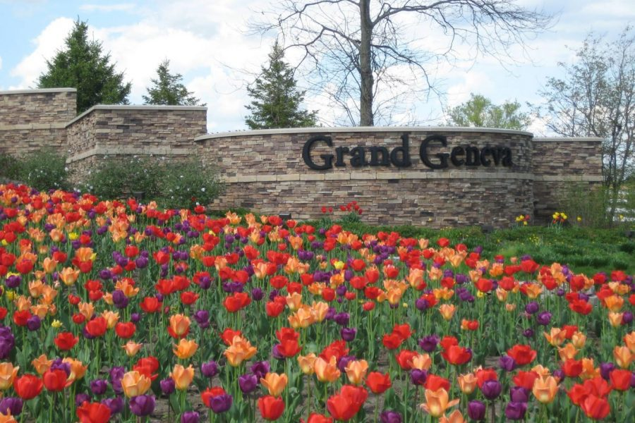 Flowers in front of entry Grand Geneva sign