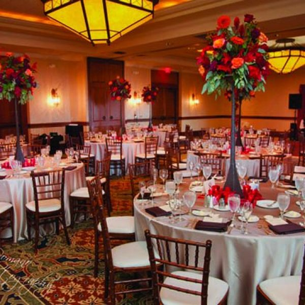 Wedding reception with Red accents and flowers at Grant Geneva