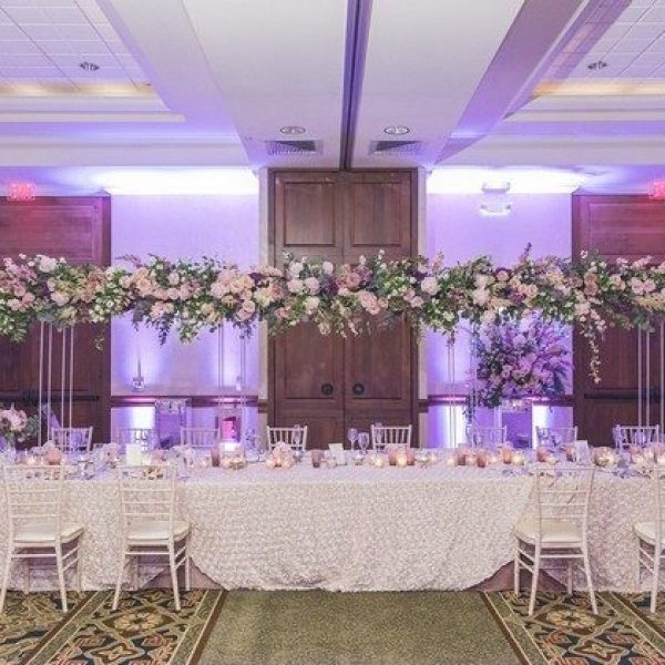 dramatic head table with gorgeous overhead flowers