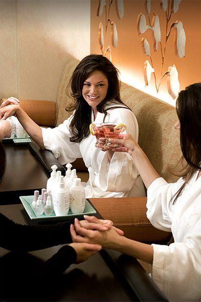 bride and bridesmaids enjoy a spa day.