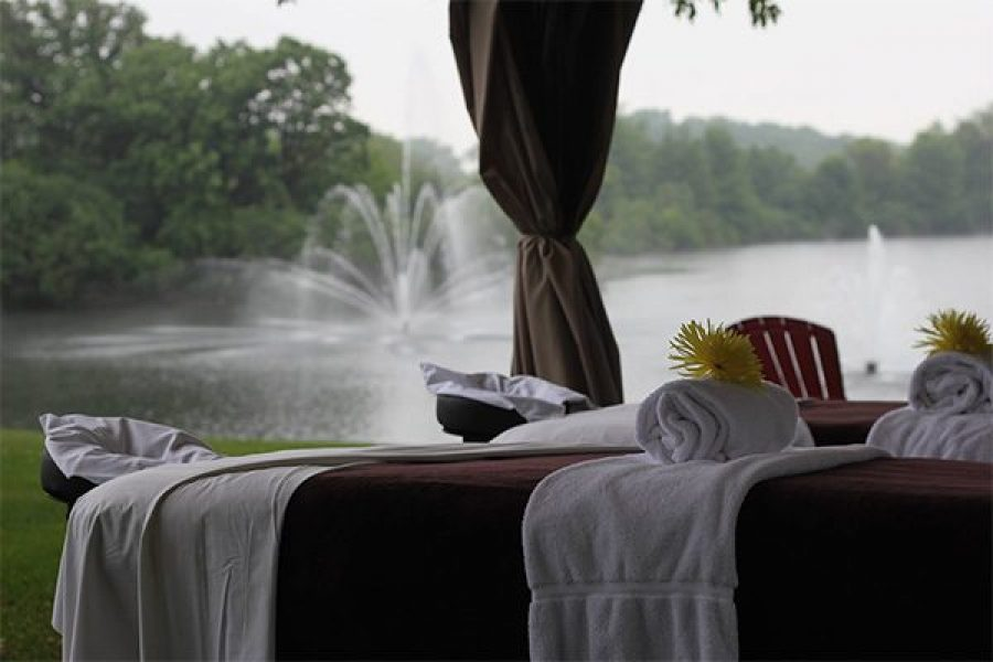 Massage table overlooking water and fountain