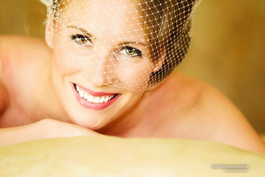 Beautiful bride wearing birdcage veil | Ideal Impressions Photography