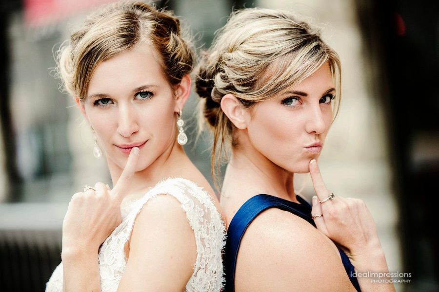 Bride and bridesmaid pose for a cute shot | Ideal Impressions Photography