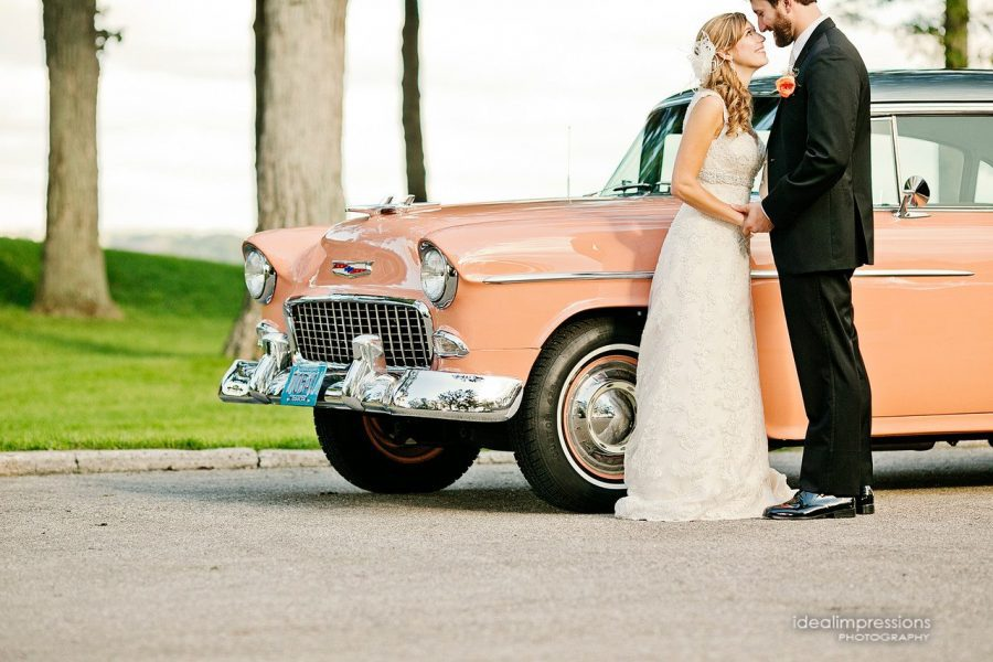 Bride and groom by vintage pink car | Ideal Impressions Photography