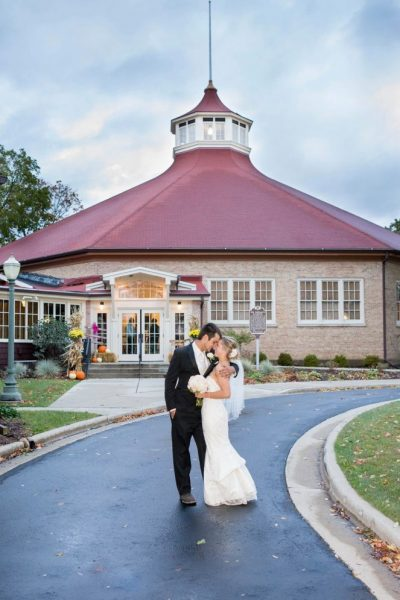 Bride and groom kiss outside the Chandelier Ballroom in Hartford, WI