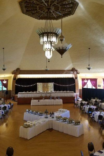Art Decco ballroom dramatically set up for wedding reception