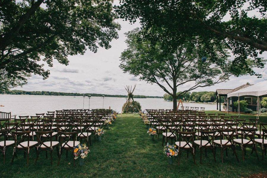 Wedding ceremony on Lake Geneva with wooden cross back chairs from All Star Rentals
