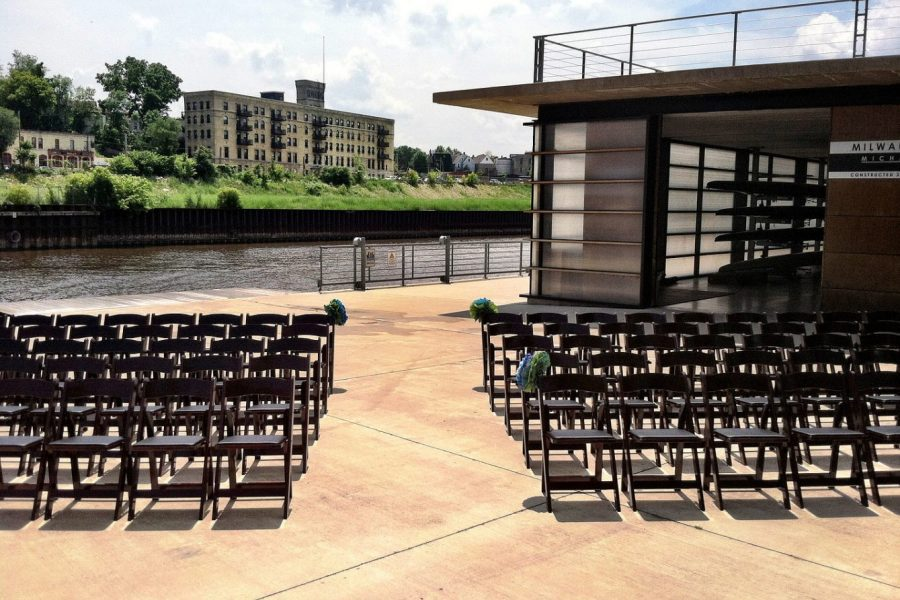 Black wood garden chairs at wedding ceremony. Chairs from All Star Rentals in Muskego, WI