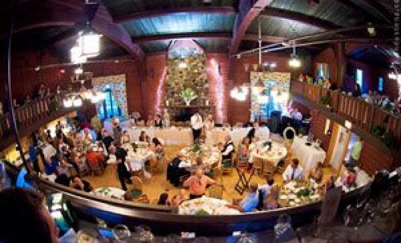 View of wedding reception from upper level looking down