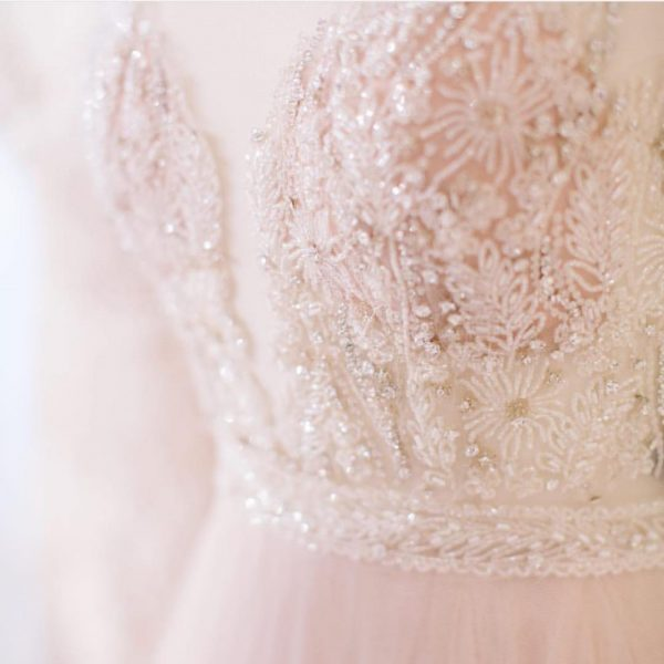 detail of soft pink wedding gown