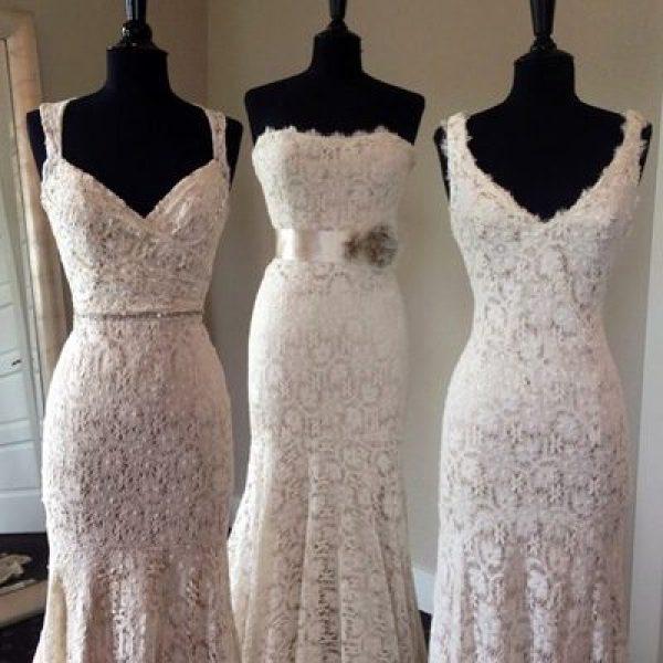 three wedding dresses on manikins