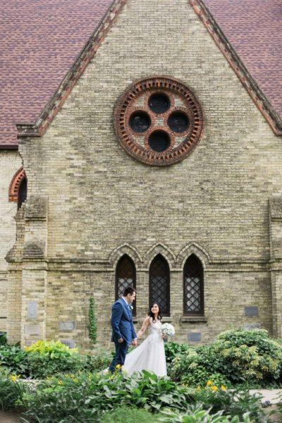 Bride and groom walk outside the wedding chapel.