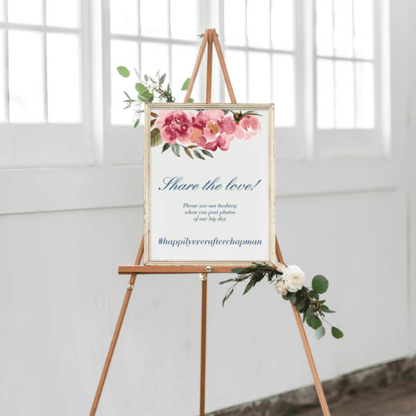 Welcome wedding sign displayed on wooden tripod.