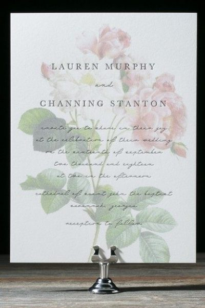 Personalized wedding invitation displayed standing up in stand