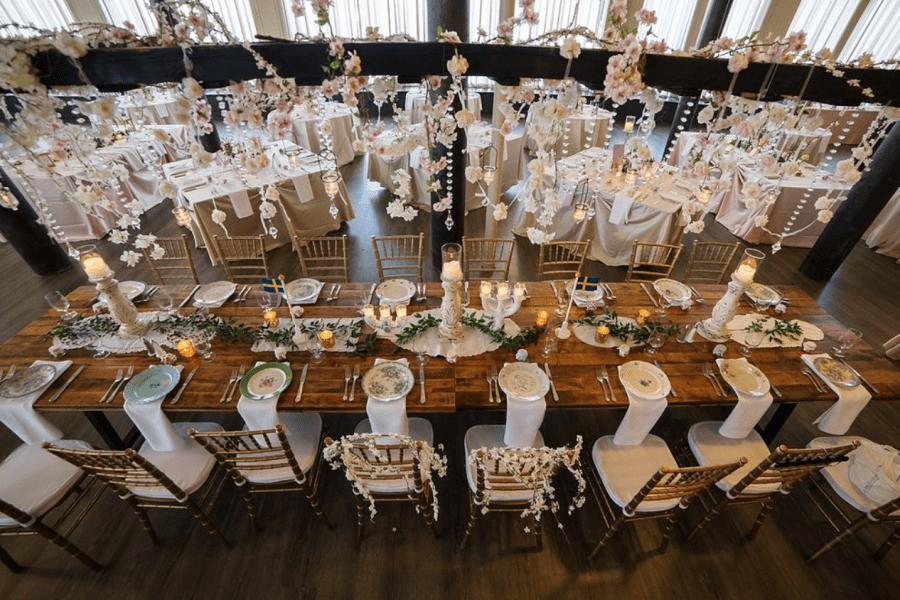 Dramatic view from above of beautiful wedding reception with variety of table shapes and centerpieces