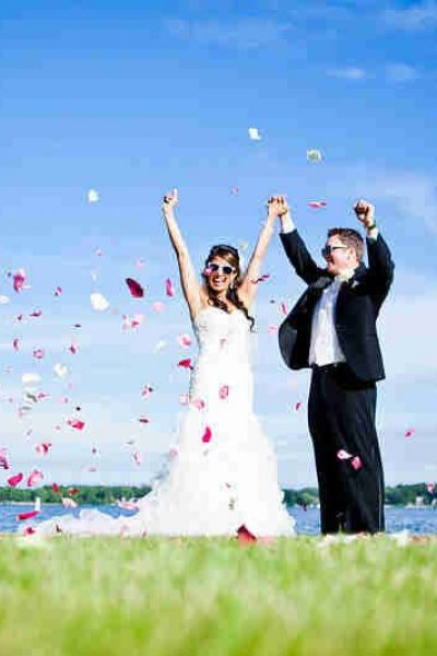 wedding couple outside at Lake Lawn Resort throwing confetti