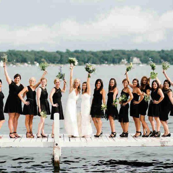 Large Bridemaids and brides on deck at lake lawn resort