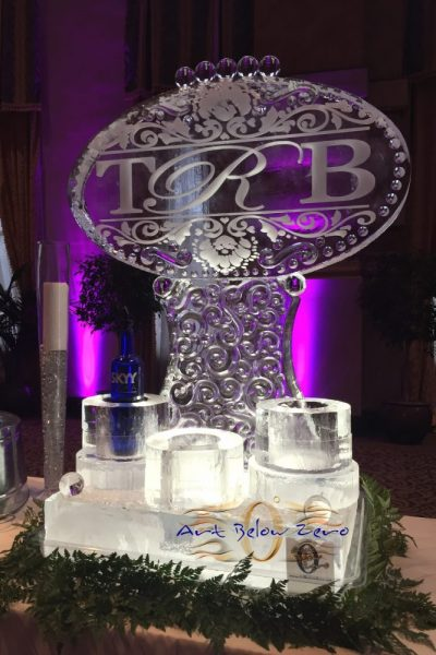 Monogram with Damasque Ornaments and vodka holders ice sculpture
