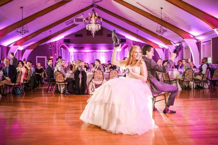 Bride and Groom playing the wedding shoe game at Tuscan Hall Banquet Center in Waukesha, WI