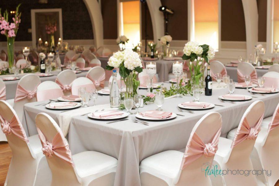 Elegant wedding reception with white & pink linens
