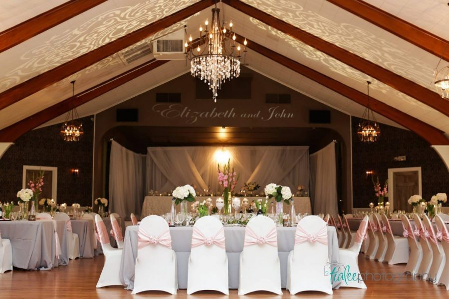 Wedding reception in white and pink at the Tuscan Hall Banquet Center