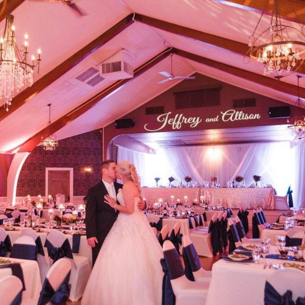 Bride and groom kiss at their elegant wedding reception