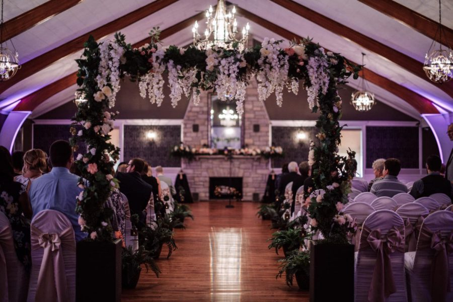 Wedding ceremony by the fireplace at the Tuscan Hall Banquet Center
