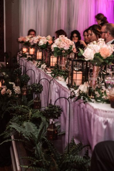 Beautiful head table with lanterns and bridal bouquets at Tuscan Hall in Waukesha, WI