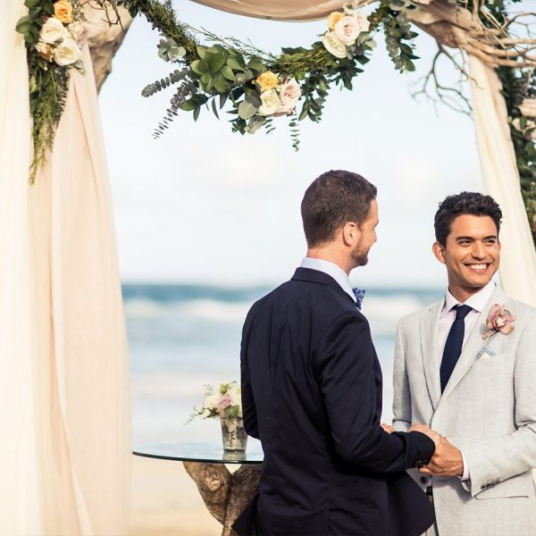 groom and groom wedding ceremony on beach for Destination weddings