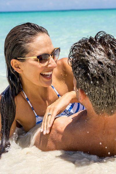 Intimate couple enjoying ocean on honeymoon