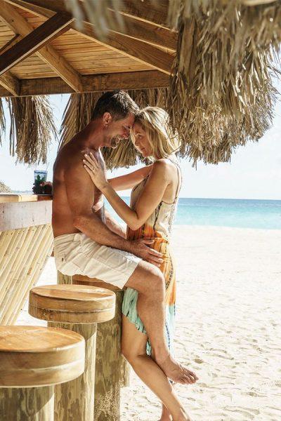Intimate honeymoon moment by Beachside bar