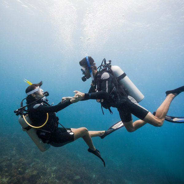 Underwater image of couple scuba diving