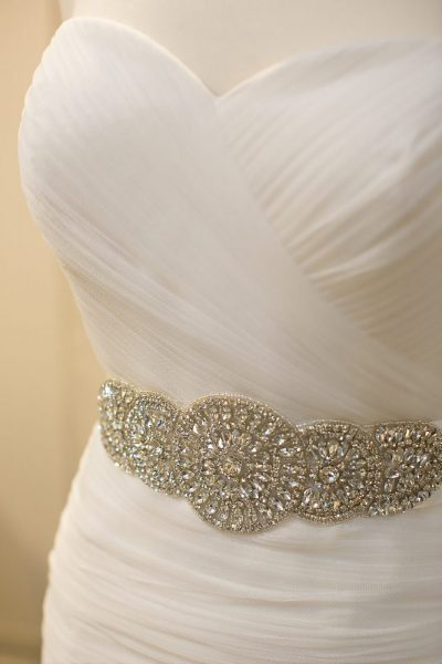 detail image of beautiful gown showcasing jeweled waste