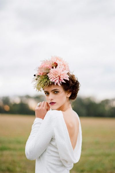 Bride image with large flower headpiece and professional makeup