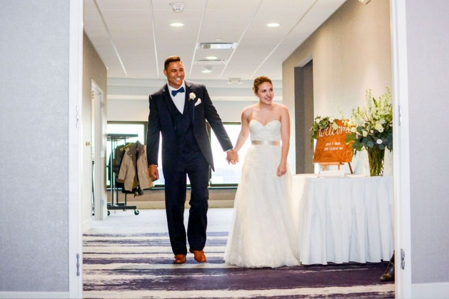 Bride and groom enter their reception at the Hyatt Regency Milwaukee