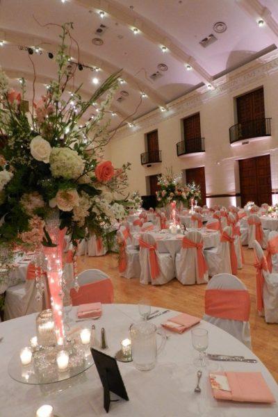 Beautiful Ballroom set up for wedding in orange, peach colors
