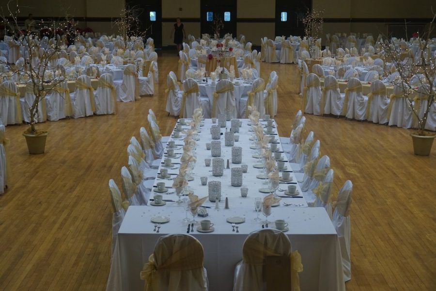 White and gold color in ballroom decorated for wedding reception