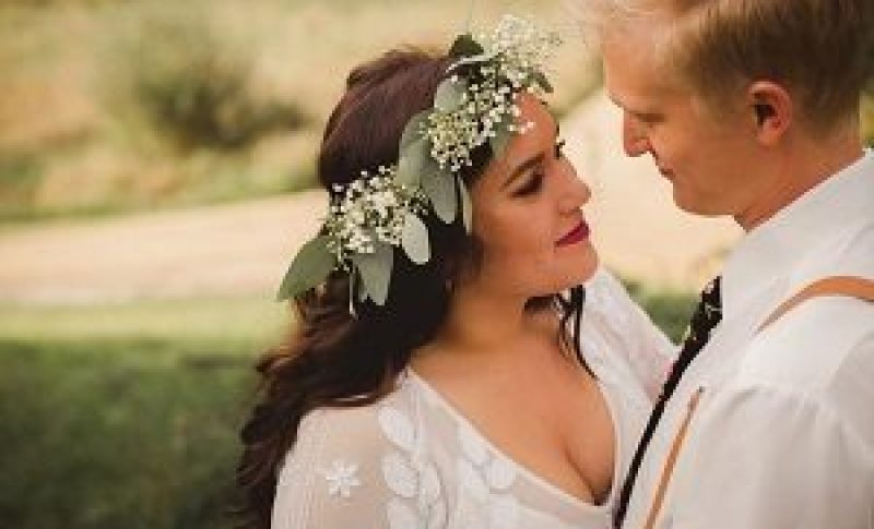 Intimate picture of wedding couple looking into each others eyes