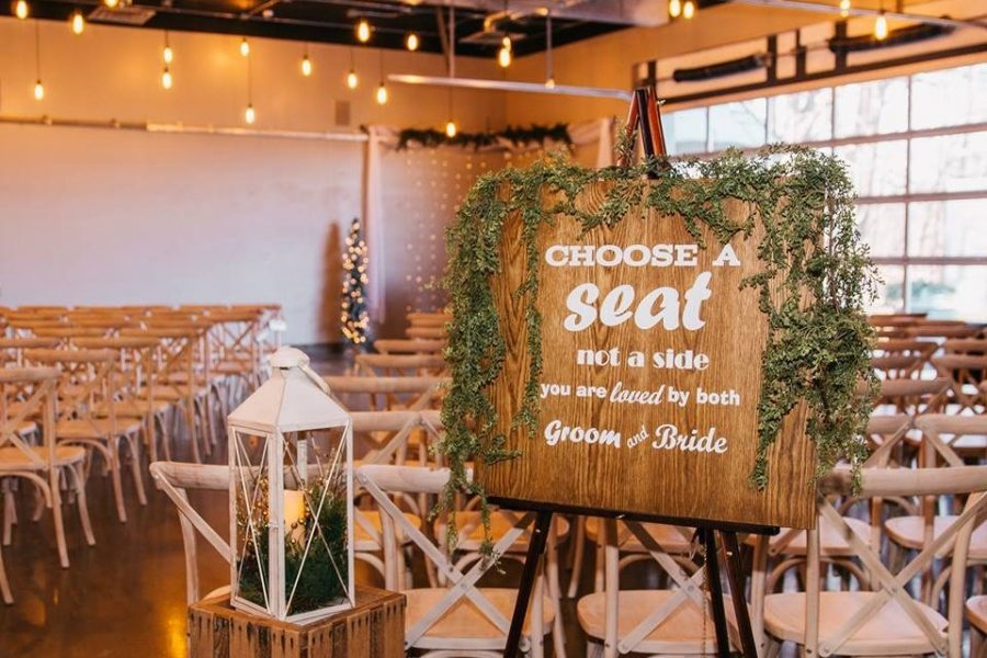 Choose a seat wooden sign at indoor wedding ceremony at Terrace 167 in Richfield, WI