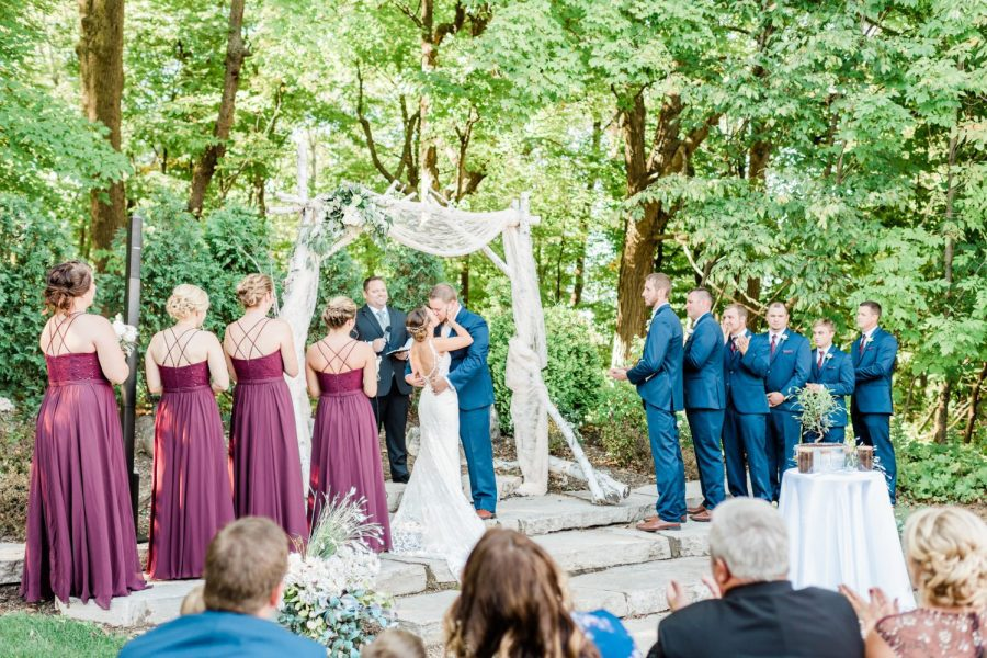 Bride and groom kiss at outdoor wedding ceremony at Terrace 167 in Richfield, WI
