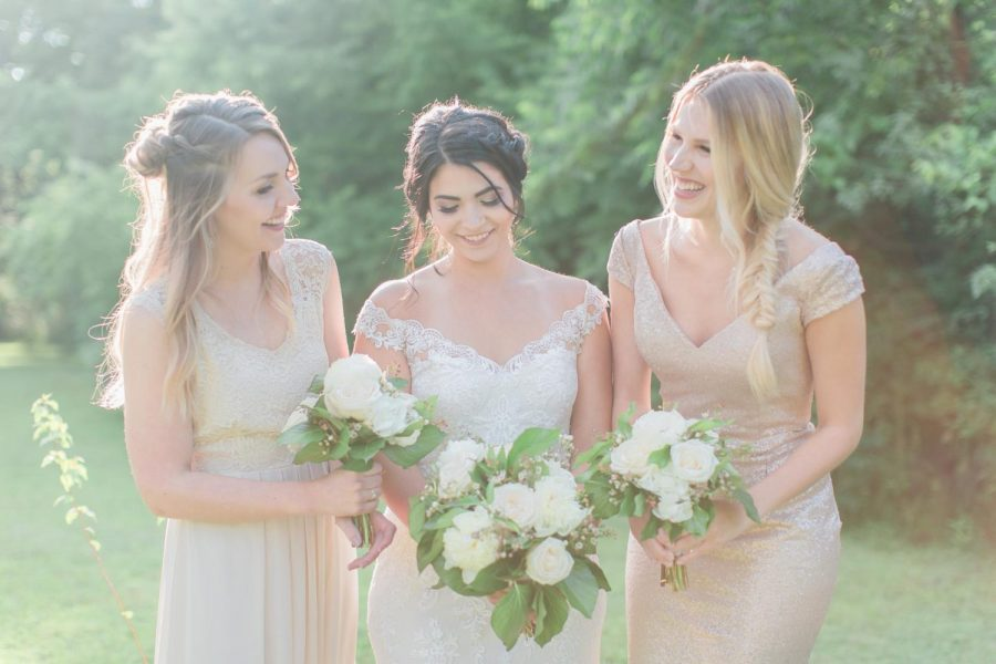 Bride and bridesmaids holding their flowers bouquets