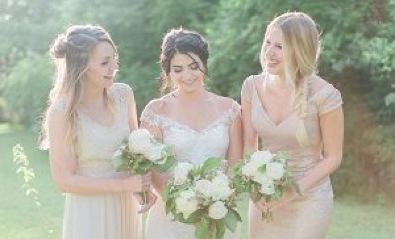 Bride and two Bridesmaid holding their wedding bouquets