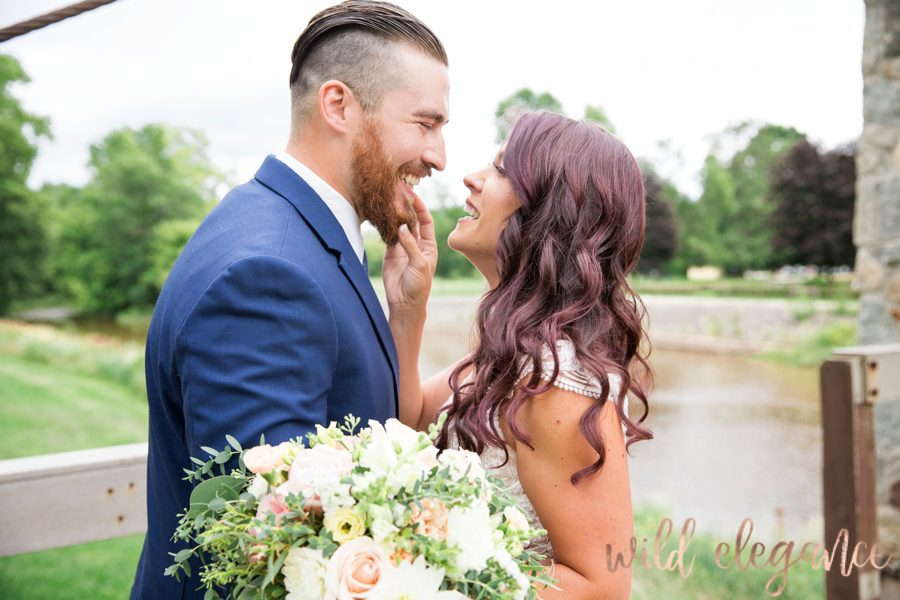 adorable candid moment of wedding couple outside