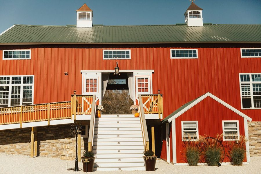 Exterior of red barn with staircase leading up