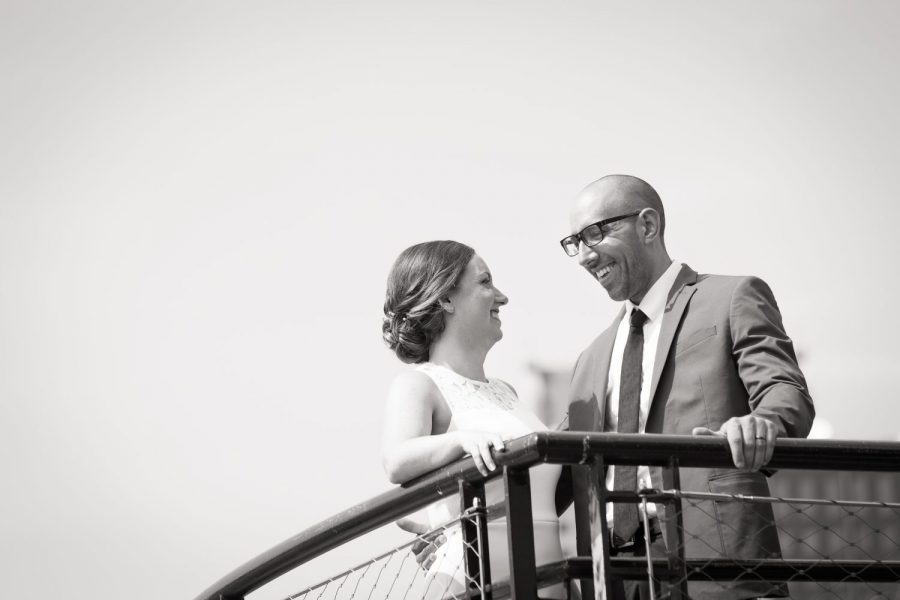 Bride and groom smile at each other- Cream City Weddings- Milwaukee weddings