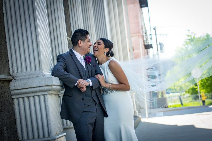 Bride and groom laugh together- Cream City Weddings
