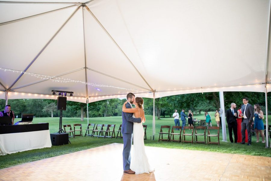 Bride and groom's first dance under the tent at the Club at Lac La Belle in Oconomowoc, WI.