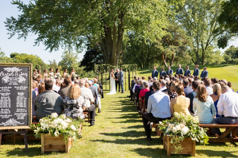 Beautiful summer wedding ceremony at the Club at Lac La Belle.