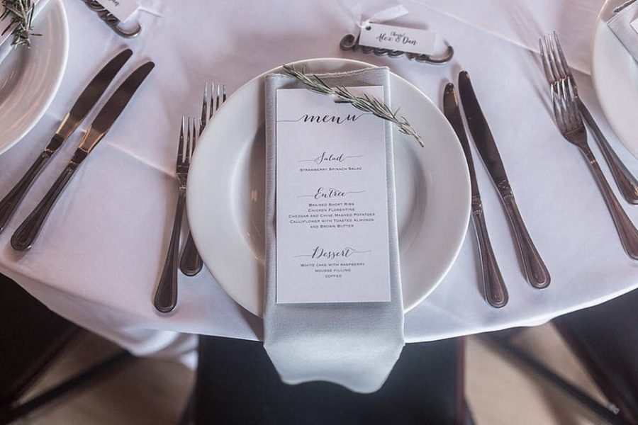 Menu card laid out on white china