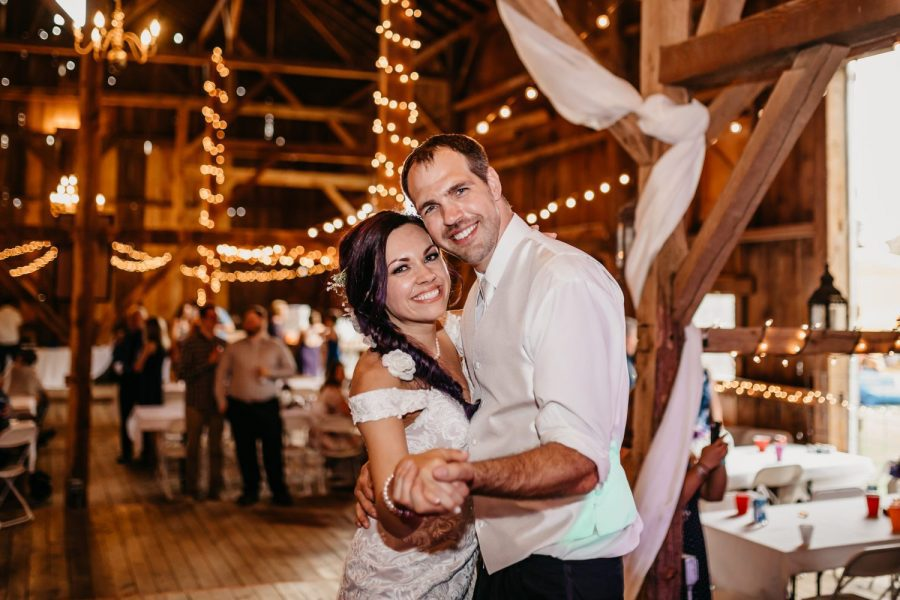 Bride and groom dancing at barn reception